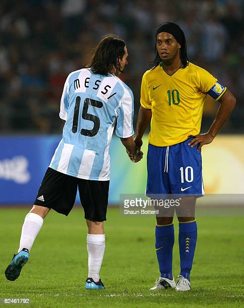 Lionel Messi of Argentina and Ronaldinho of Brazil shake hands during the men's football semifinal match between Argentina and Brazil at Workers'...