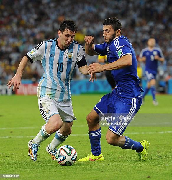 Lionel Messi of Argentina and Sead Kolasinac of BosniaHerzegovina