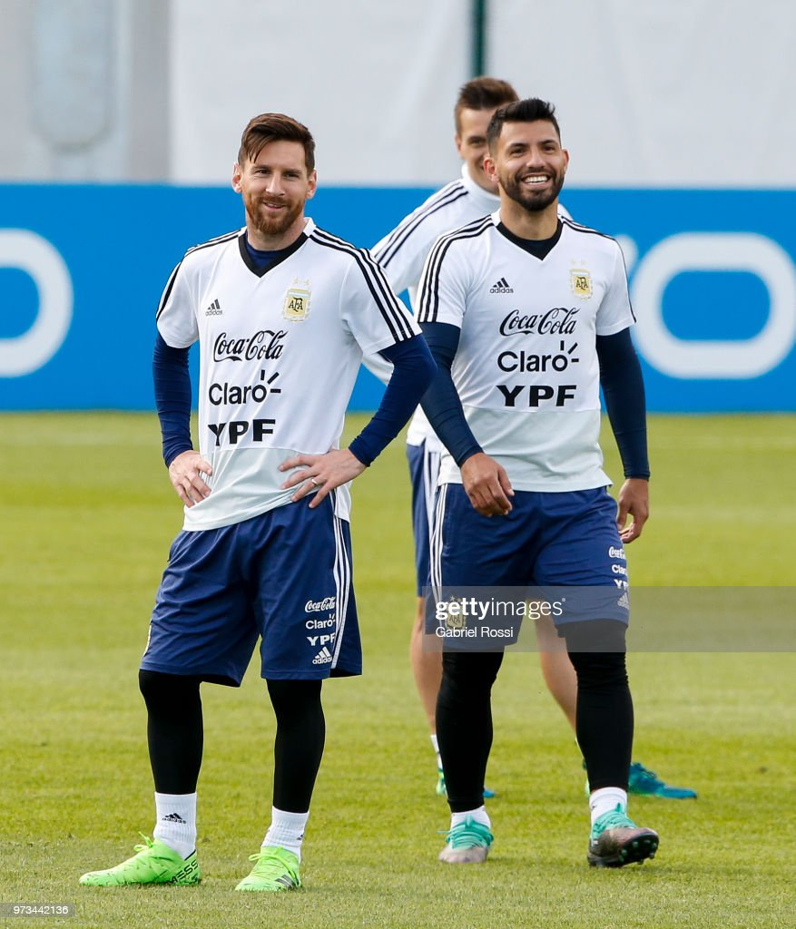 Lionel Messi of Argentina and Sergio Aguero of Argentina laugh during an open to public training session at Bronnitsy Training Camp on June 11, 2018 in Bronnitsy, Russia.