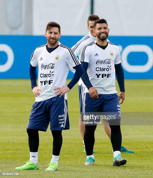 Lionel Messi of Argentina and Sergio Aguero of Argentina laugh during an open to public training session at Bronnitsy Training Camp on June 11, 2018...