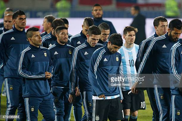 Lionel Messi of Argentina and teammates look dejected after the 2015 Copa America Chile Final match between Chile and Argentina at Nacional Stadium...