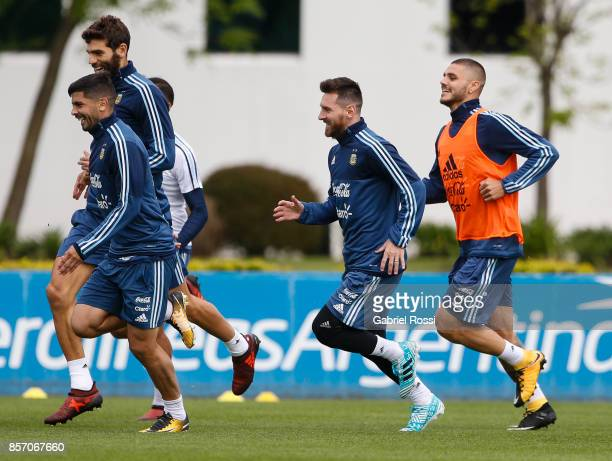 Lionel Messi of Argentina and teammates run during a training session at Argentine Football Association 'Julio Humberto Grondona' training camp on...