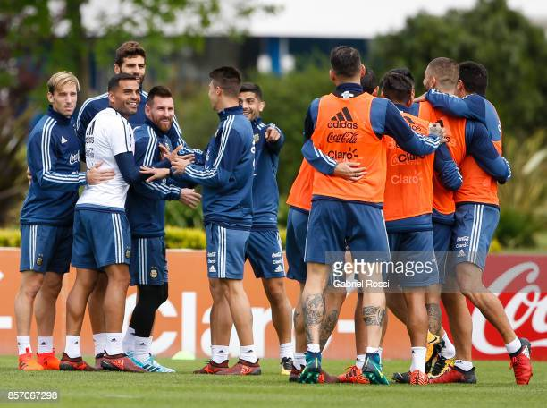 Lionel Messi of Argentina and teammates smiles during a training session at Argentine Football Association 'Julio Humberto Grondona' training camp on...