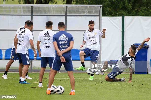 Lionel Messi of Argentina and teammates warm up during a training session at Stadium of Syroyezhkin sports school on June 19 2018 in Bronnitsy Russia