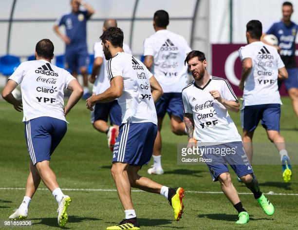 Lionel Messi of Argentina and teammates warm up during a training session at Stadium of Syroyezhkin sports school on June 23 2018 in Bronnitsy Russia