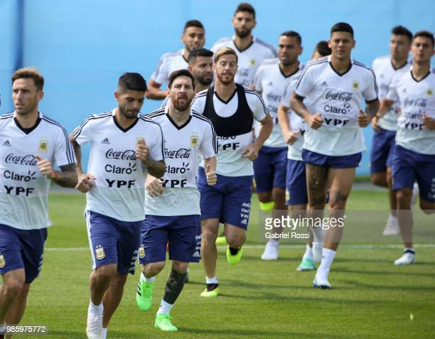 Lionel Messi of Argentina and teammates warm up during a training session at Stadium of Syroyezhkin sports school on June 27 2018 in Bronnitsy Russia