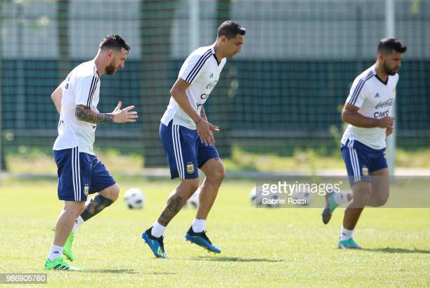 Lionel Messi of Argentina and teammates warm up during a training session at Stadium of Syroyezhkin sports school on June 28 2018 in Bronnitsy Russia