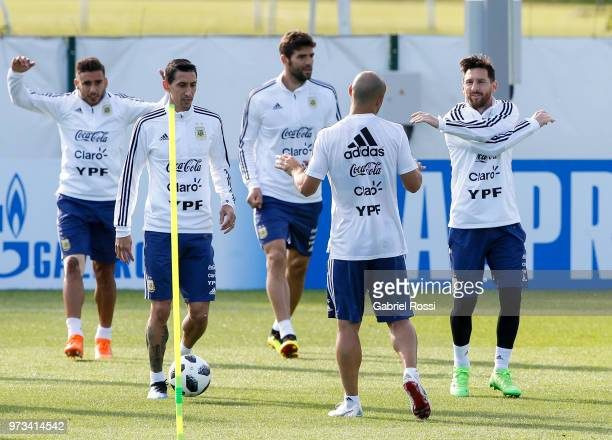 Lionel Messi of Argentina and teammates warm up during an open to public training session at Bronnitsy Training Camp on June 11 2018 in Bronnitsy...