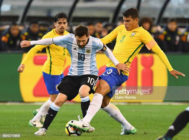 Lionel Messi of Argentina and Thiago Silva of Brazil compete for the ball during the Brazil Global Tour match between Brazil and Argentina at...