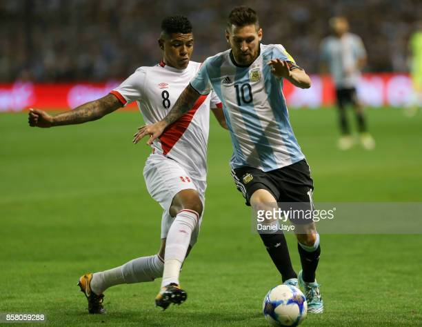 Lionel Messi of Argentina and Wilder Cartagena of Peru fight for the ball during a match between Argentina and Peru as part of FIFA 2018 World Cup...