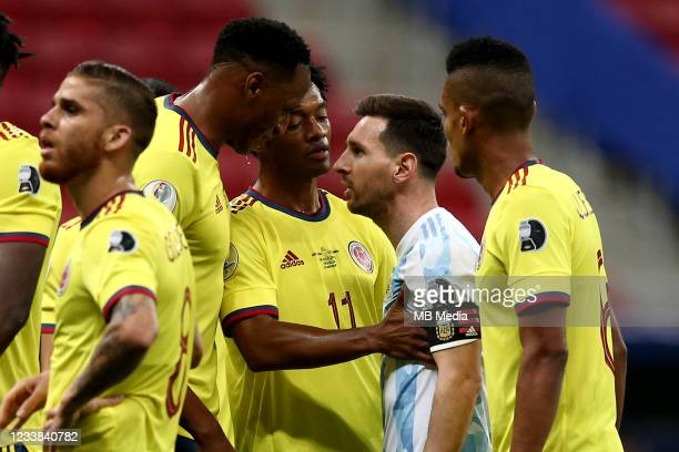 Lionel Messi of Argentina argues with Juan Cuadrado and Yerry Mina of Colombia during the semifinal match between Argentina and Colombia as part of...