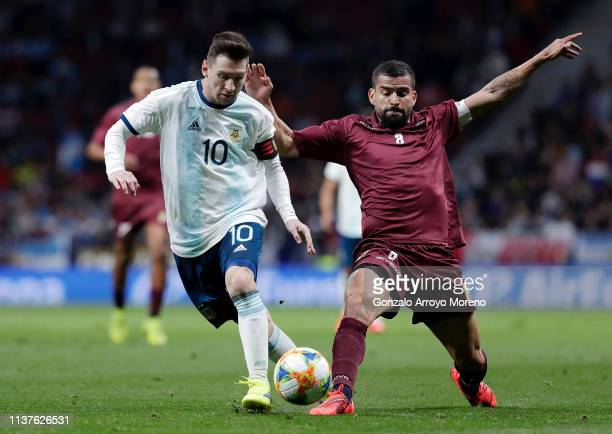 Lionel Messi of Argentina battles for possession with Tomas Rincon of Venezuela during the International Friendly match between Argentina and...