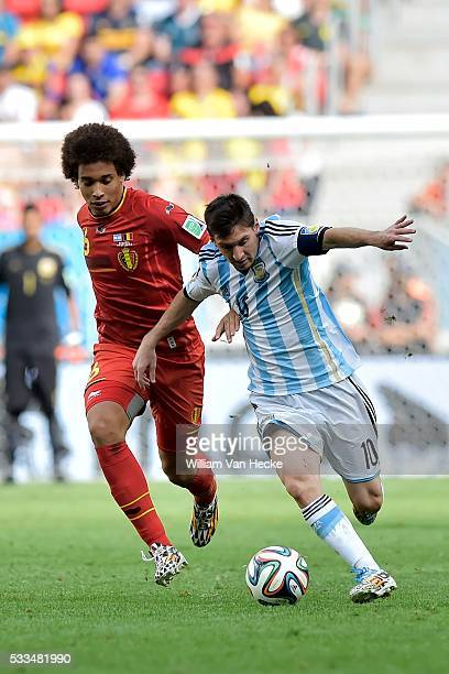 Lionel Messi of Argentina battles for the ball with Axel Witsel of Belgium during a FIFA 2014 World Cup Quarter-Final match between Argentina and...