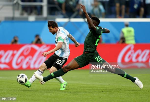 Lionel Messi of Argentina beat the challenge from Kenneth Omeruo of Nigeria to score his team's first goal during the 2018 FIFA World Cup Russia...