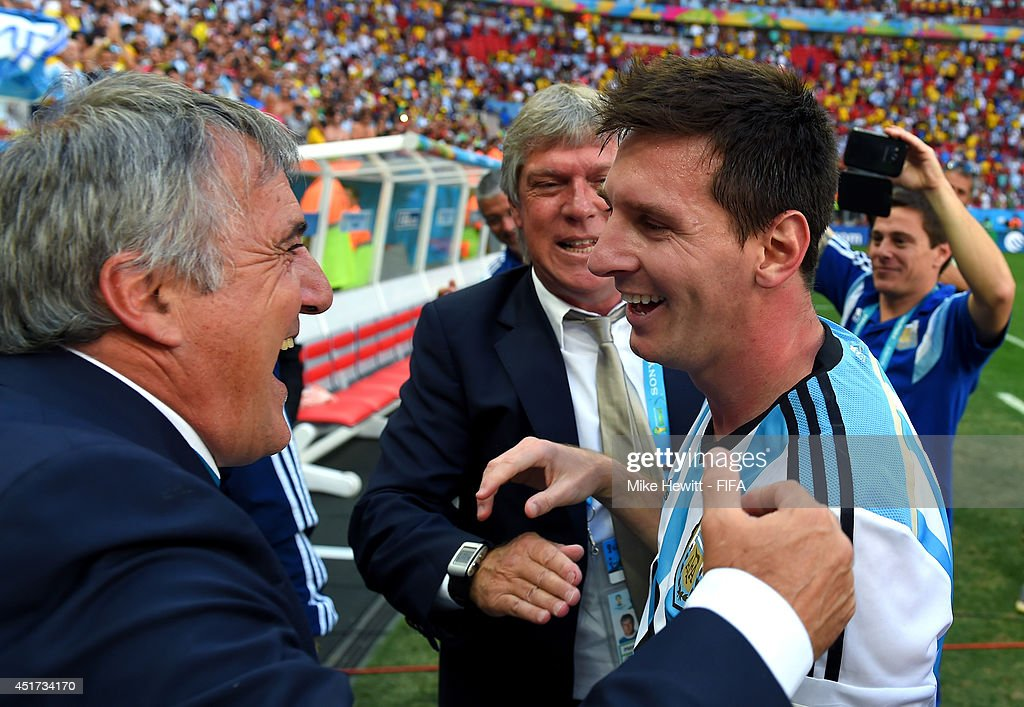 Lionel Messi of Argentina celebates the 1-0 win with a team staff after the 2014 FIFA World Cup Brazil Quarter Final match between Argentina and Belgium at Estadio Nacional on July 5, 2014 in Brasilia, Brazil.