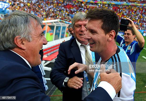 Lionel Messi of Argentina celebates the 1-0 win with a team staff after the 2014 FIFA World Cup Brazil Quarter Final match between Argentina and...