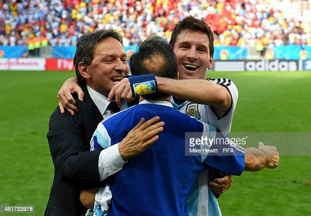 Lionel Messi of Argentina celebates the 1-0 win with team staffs after the 2014 FIFA World Cup Brazil Quarter Final match between Argentina and...