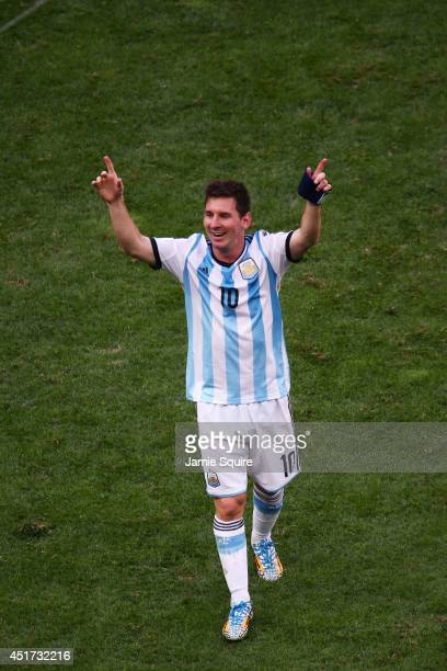 Lionel Messi of Argentina celebrates after defeating Belgium 10 during the 2014 FIFA World Cup Brazil Quarter Final match between Argentina and...