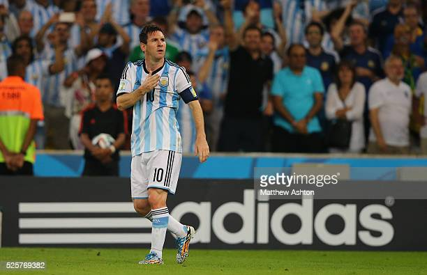 Lionel Messi of Argentina celebrates after scoring a goal to make it 20 in front of an Adidas sign