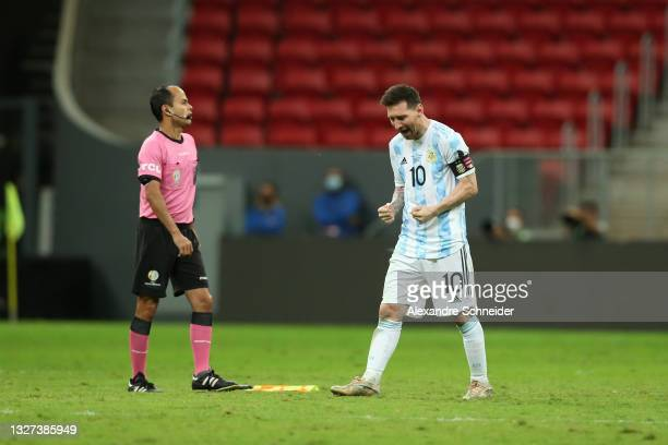 Lionel Messi of Argentina celebrates after scoring his penalty kick during a shootout after a semi-final match of Copa America Brazil 2021 between...