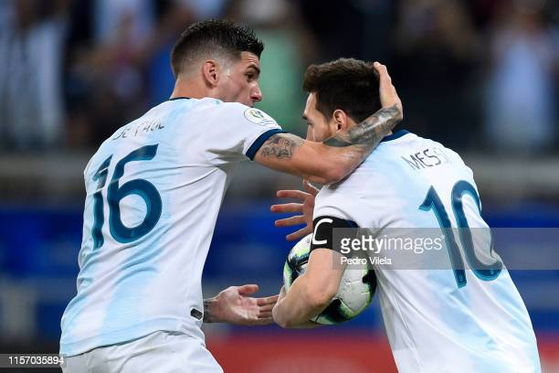 Lionel Messi of Argentina celebrates after scoring the equalizer via penalty with teammate Rodrigo De Paul during the Copa America Brazil 2019 group...
