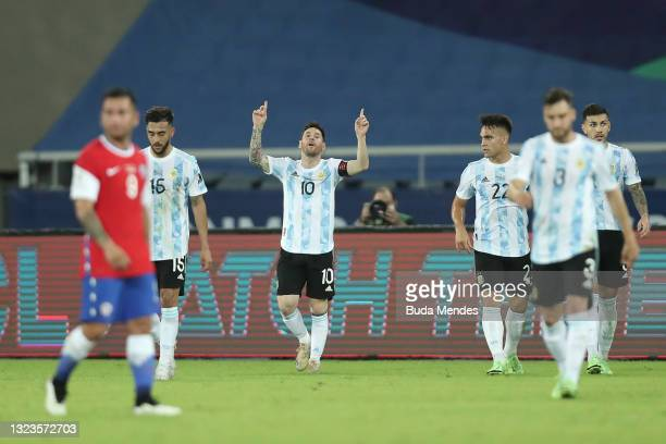 Lionel Messi of Argentina celebrates after scoring the first goal of his team during a Group A match between Argentina and Chile at Estadio Olímpico...
