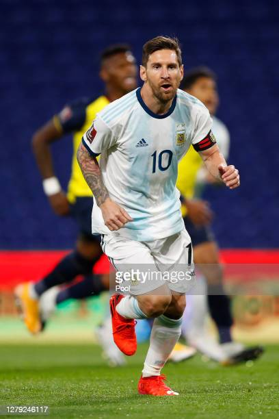 Lionel Messi of Argentina celebrates after scoring the opening goal of his team with a penalty kick during a match between Argentina and Ecuador as...