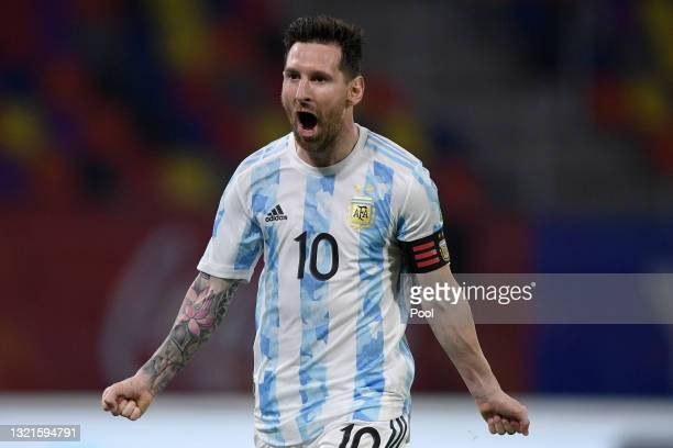 Lionel Messi of Argentina celebrates after scoring the opening goal of his team with a penalty kick during a match between Argentina and Chile as...