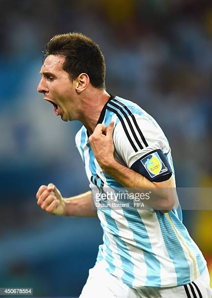 Lionel Messi of Argentina celebrates after scoring the team's second goal during the 2014 FIFA World Cup Brazil Group F match between Argentina and...