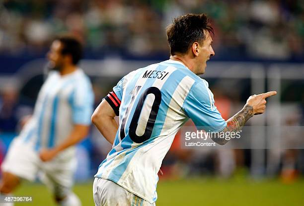 Lionel Messi of Argentina celebrates after scoring the tying goal during a friendly match between Argentina and Mexico at ATT Stadium on September 08...