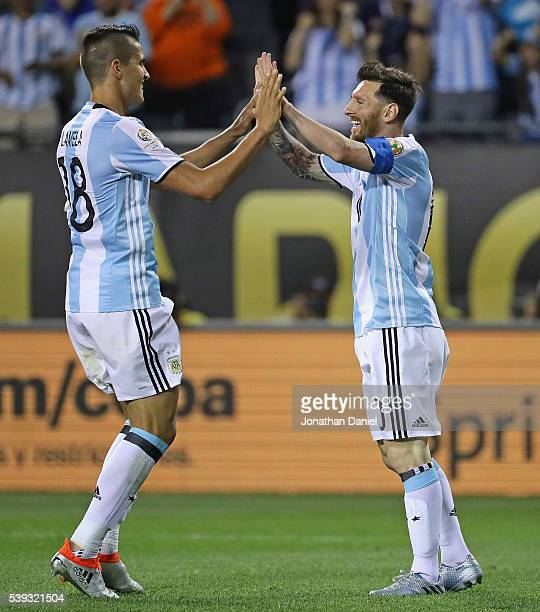 Lionel Messi of Argentina celebrates his first goal of the match with teammate Erik Lamela against Panama during a match in the 2016 Copa America...