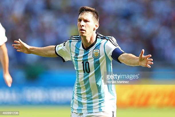 Lionel Messi of Argentina celebrates scoring his team's first goal during the 2014 FIFA World Cup Brazil Group F match between Argentina and Iran at...