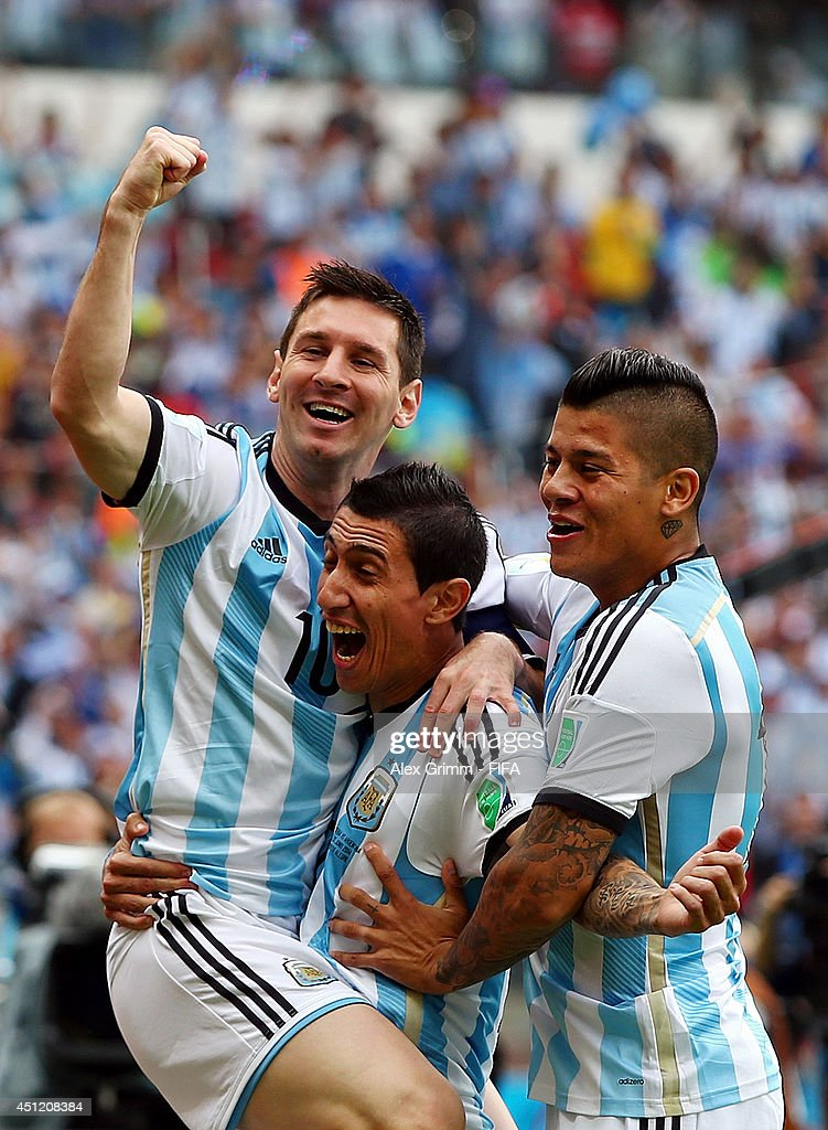 Lionel Messi (L) of Argentina celebrates scoring his team's first goal with his teammates Angel di Maria (C) and Marcos Rojo (R) during the 2014 FIFA World Cup Brazil Group F match between Nigeria and Argentina at Estadio Beira-Rio on June 25, 2014 in Porto Alegre, Brazil.