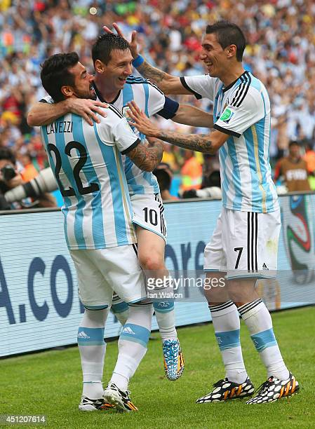 Lionel Messi of Argentina celebrates scoring his team's second goal and his second of the game with Ezequiel Lavezzi and Angel di Maria during the...