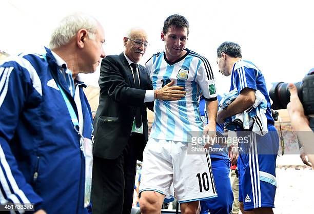 Lionel Messi of Argentina celebrates the 1-0 win while walking off the pitch after the 2014 FIFA World Cup Brazil Quarter Final match between...