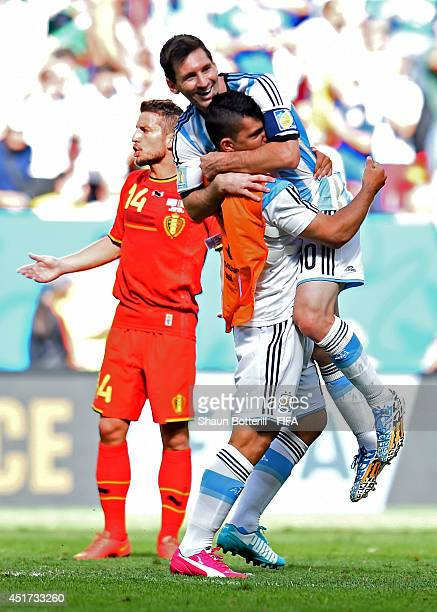 Lionel Messi of Argentina celebrates the 1-0 win with his teammate Sergio Aguero after the 2014 FIFA World Cup Brazil Quarter Final match between...