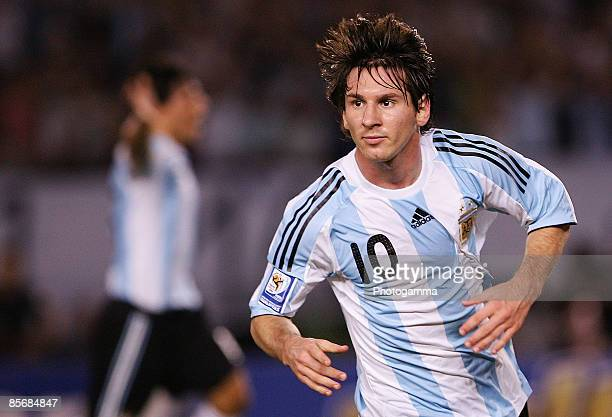 Lionel Messi of Argentina celebrates the first goal during the 2010 FIFA World Cup South African qualifier match between Argentina and Venezuela at...