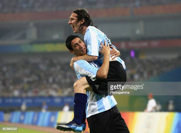 Lionel Messi of Argentina celebrates the first goal with teammate Angel Di Maria during the Men's Quarter Final match between Argentina and...