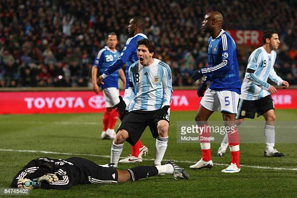 Lionel Messi of Argentina celebrates the opening goal scored by Jonas Gutierrez during the International Friendly match between France and Argentina...