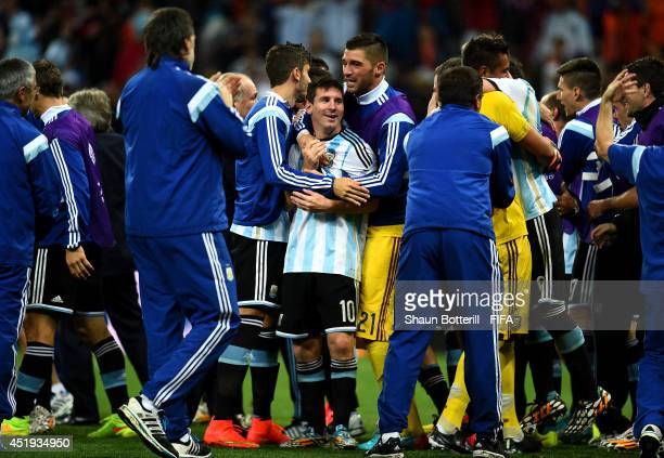 Lionel Messi of Argentina celebrates the win with his teammates after the 2014 FIFA World Cup Brazil Semi Final match between Netherlands and...