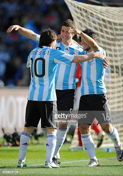 Lionel Messi of Argentina celebrates with Gonzalo Higuain of Argentina and Sergio Aguero of Argentina after the third goal