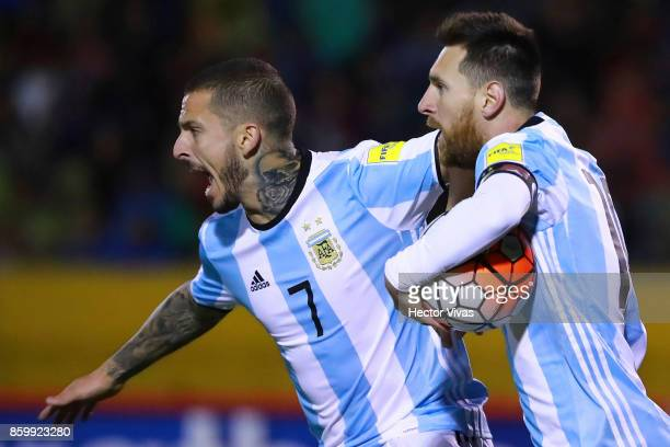 Lionel Messi of Argentina celebrates with teammate Dario Benedetto after scoring the first goal of his team during a match between Ecuador and...