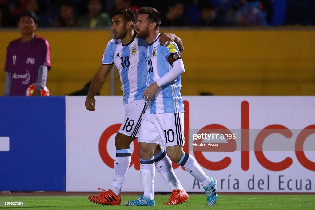 Lionel Messi of Argentina celebrates with teammate Eduardo Salvio after scoring the second goal of his team during a match between Ecuador and Argentina as part of FIFA 2018 World Cup Qualifiers at Olimpico Atahualpa Stadium on October 10, 2017 in Quito, Ecuador.