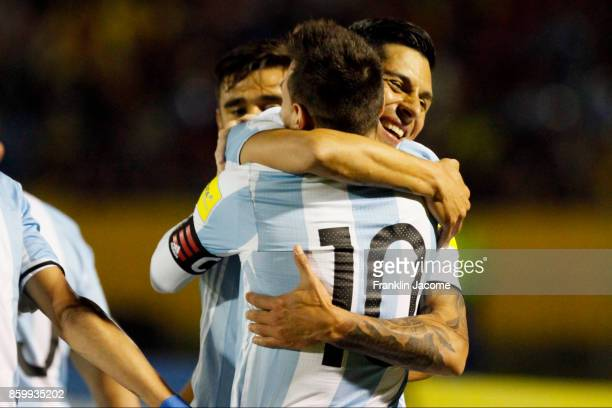 Lionel Messi of Argentina celebrates with teammate Enzo Perez after scoring the second goal of his team during a match between Ecuador and Argentina...