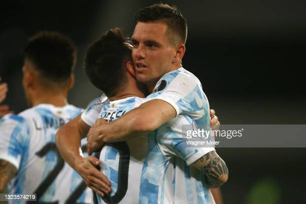 Lionel Messi of Argentina celebrates with teammate Giovani Lo Celso after scoring the first goal of his team during a Group A match between Argentina...