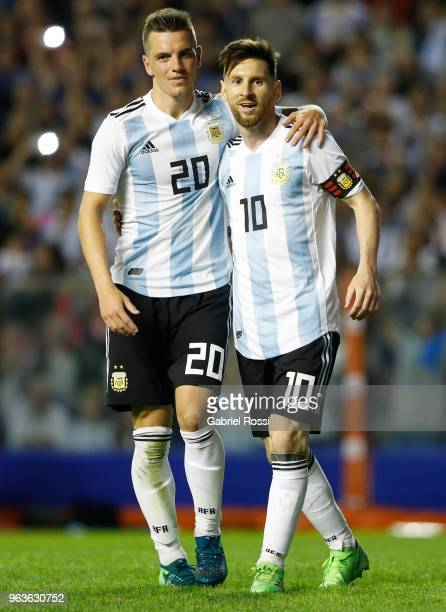 Lionel Messi of Argentina celebrates with teammate Giovani Lo Celso after scoring the second goal of his team during an international friendly match...
