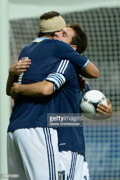 Lionel Messi of Argentina celebrates with teammate Gonzalo Higuain his team's second goal during the international friendly match between Germany and...