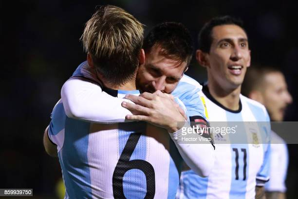 Lionel Messi of Argentina celebrates with teammate Lucas Biglia after scoring the third goal of his team during a match between Ecuador and Argentina...