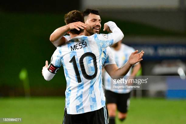 Lionel Messi of Argentina celebrates with teammate Sergio Agüero after scoring the third goal of his team during a Group A match between Argentina...