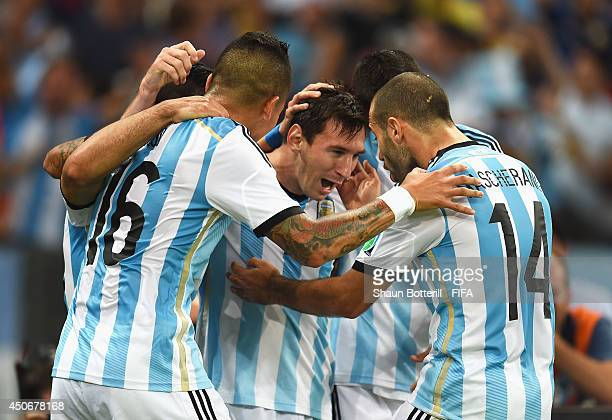 Lionel Messi of Argentina celebrates with teammates after scoring a goal during the 2014 FIFA World Cup Brazil Group F match between Argentina and...